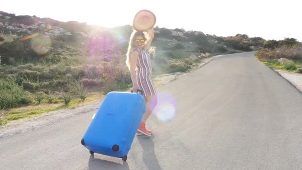 Woman traveler with suitcase running