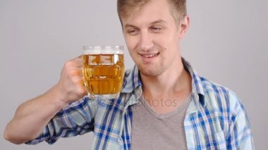 Young happy man tasting a draft beer