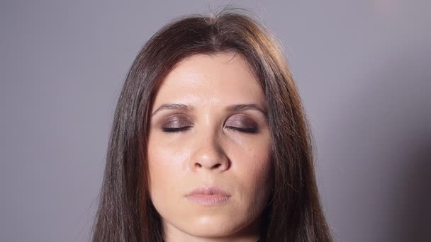 Brunette woman with dark makeup