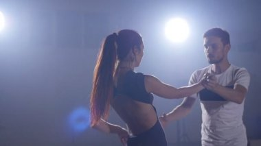 Young couple dancing bachata indoors
