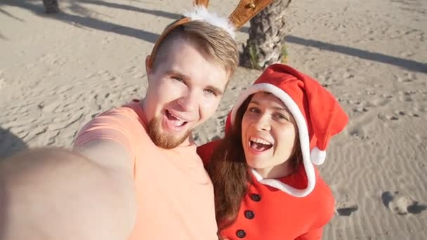 Happy smiling santa couple in love. Self portrait