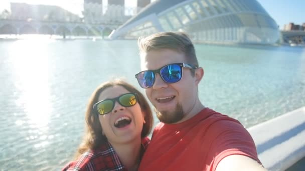 Loving cheerful happy couple taking selfie in the city Valencia