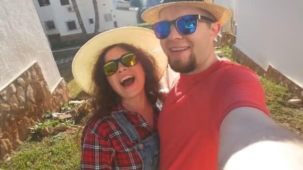 Happy travel couple in love Make funny selfie