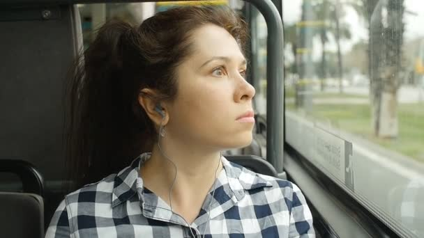 Young woman on the bus looking out the window