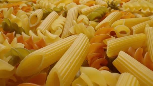 National cuisine concept. Closeup of uncooked italian pasta