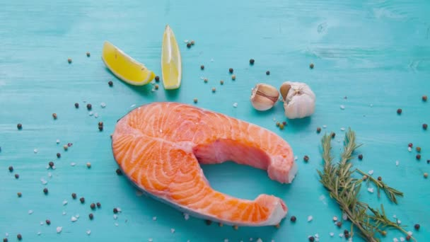Steak of raw salmon with spices on a blue background