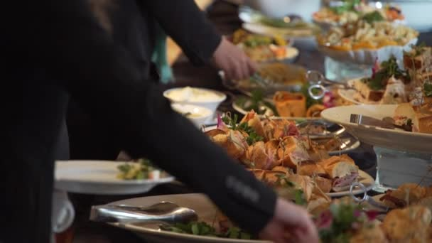 People selecting buffet food at an event