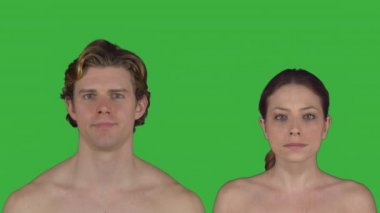 Nude couple stands facing camera (Green Key)