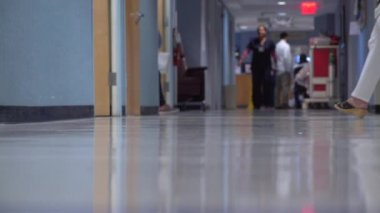 People Moving Around In A Busy Hospital Hallway