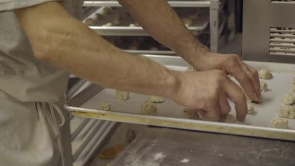 Italian baker prepares cookie dough on tray