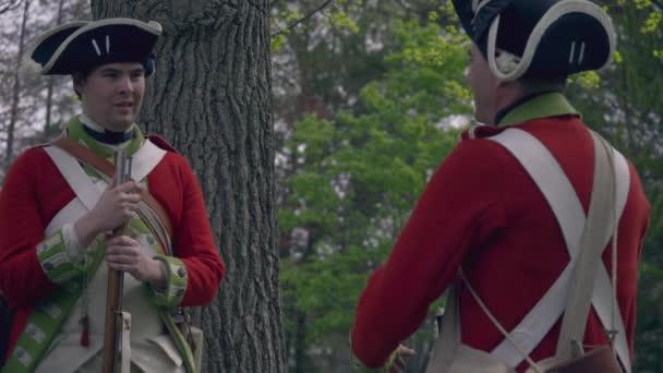 Two Revolutionary War British soldiers speak in forest