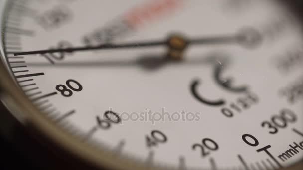 Extreme close-up nurse measures blood pressure with sphygmometer