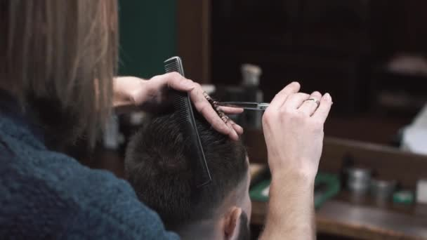 Barber Cuts the Hair in the Barbershop, close-up