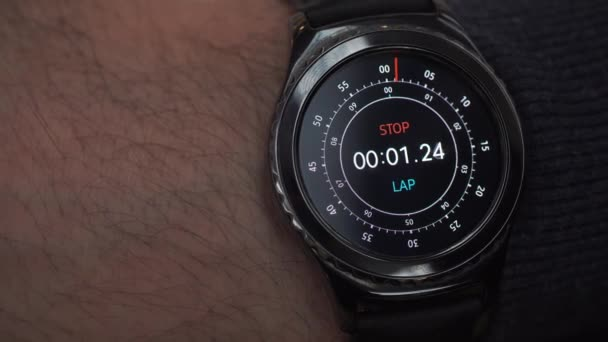 Closeup of a smart watch on male hand. Man turns on the stopwatch