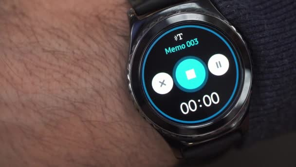 Closeup of a smart watch on male hand. The voice memo recording, audio note, audio recording