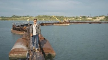 Man walks on the steel bay