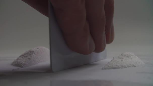 Man splits cocaine drugs on the table