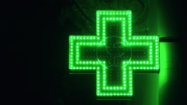 Iluminated Green Pharmaceutical Cross. Pharmacy Street Sign