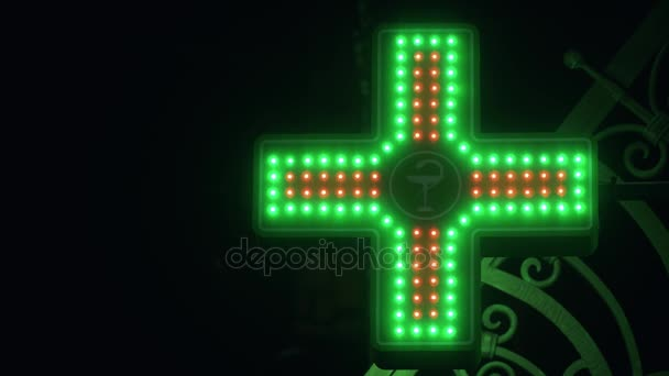 Iluminated Green And Red Pharmaceutical Cross. Pharmacy Street Sign