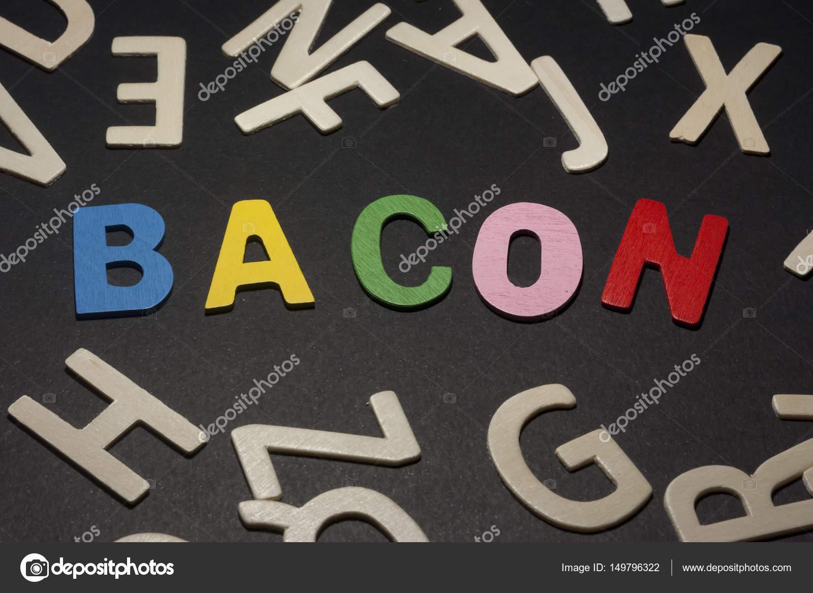 Lettere Di Legno Colorate : Bacon scritti con lettere di legno colorate su sfondo nero u2014 foto
