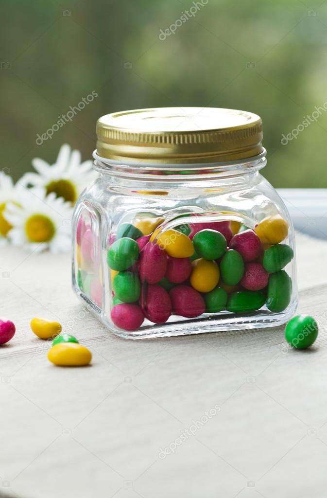 Colored dragees, candy in a glass jar — Stock Photo © lokisurina
