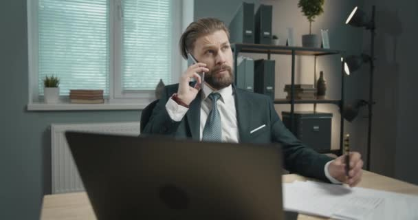 Businessman Having Phone Call in Office