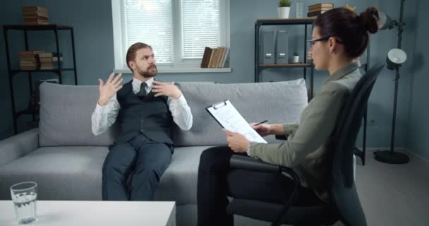 Mature man visiting female psychologist