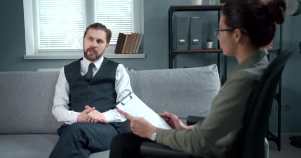 Bearded man sharing his emotional stress with psychologist