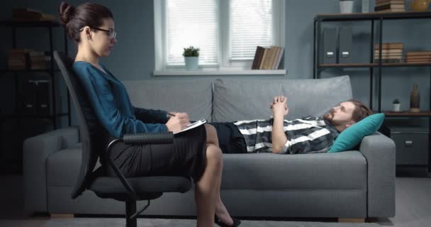 Psychologist giving advice to male patient at private office