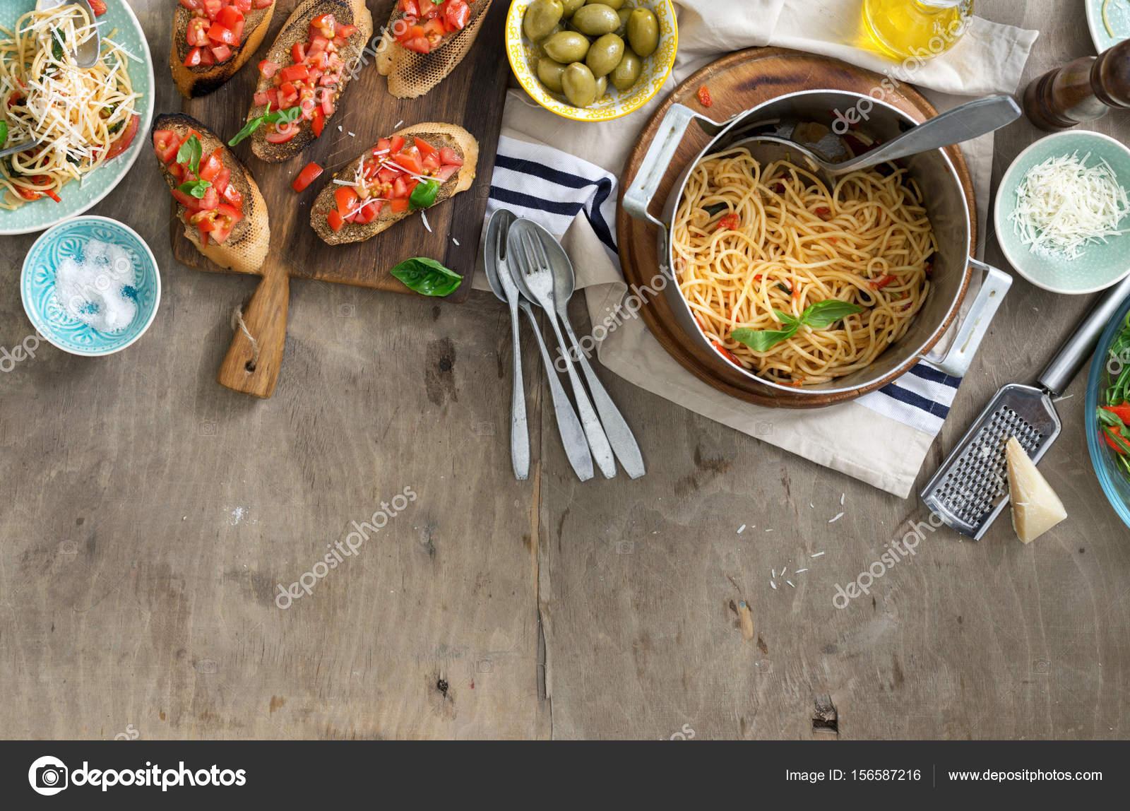 Italian Dinner Table With Pasta And Bruschetta On Wooden Table U2014 Stock  Photo #156587216