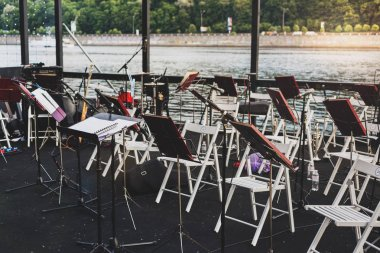 Musical instruments on the river bank in warm summer evening