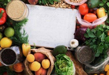 Around white wooden board abundance of healthy food