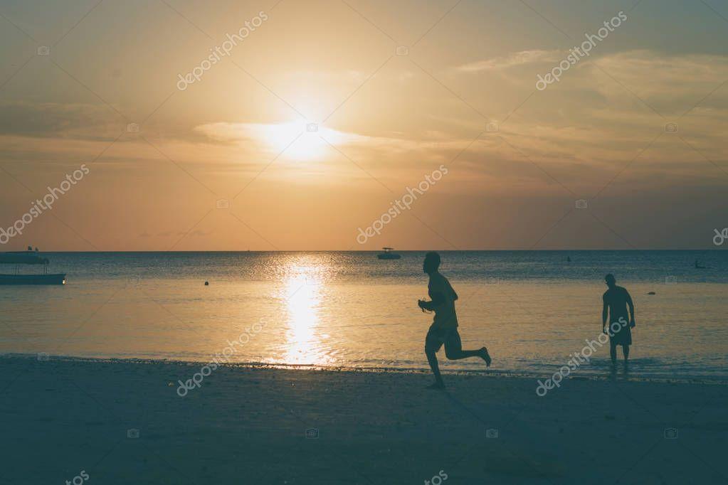 Man runs along ocean coast