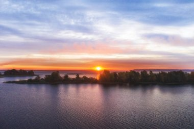 Beautiful sunrise over river with an island