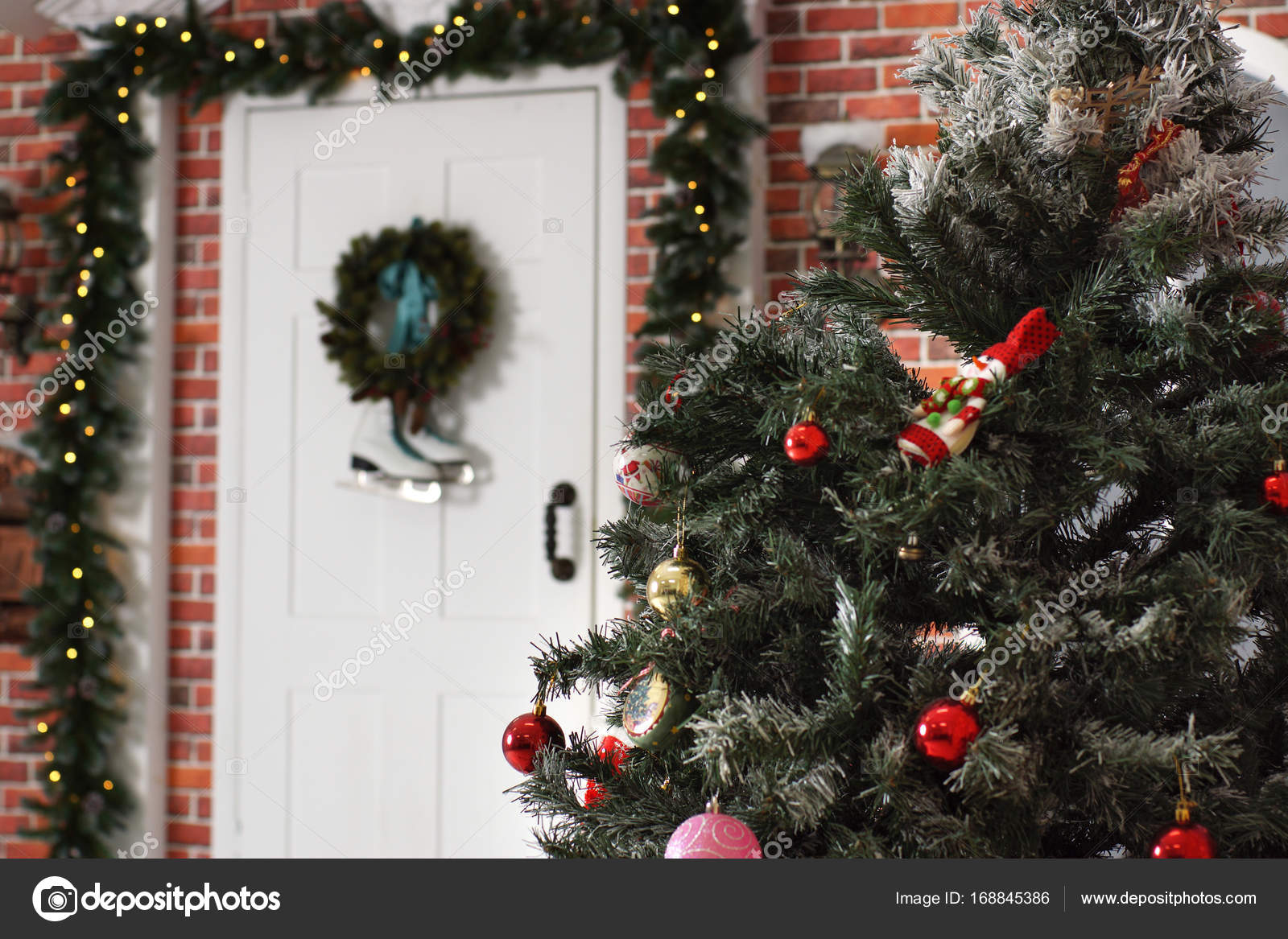a decorated christmas tree stands in the courtyard near the front door stock photo - Decorative Christmas Tree Stands