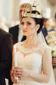 Fotografie Bride in church on wedding ceremony