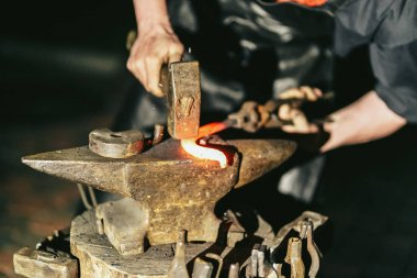 Blacksmith works with hot red steel