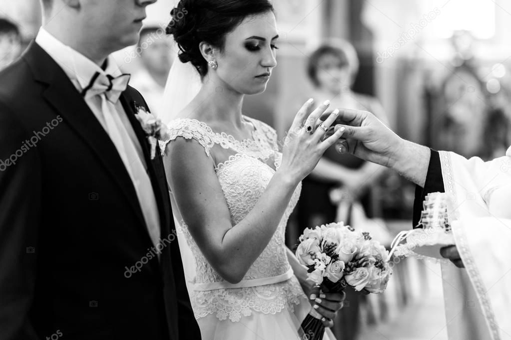 Newlyweds in church on wedding ceremony