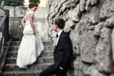 Newlyweds on a walk near old castle