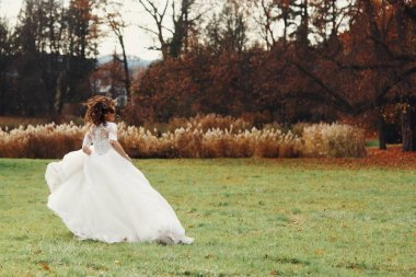 Young bride in autumn park
