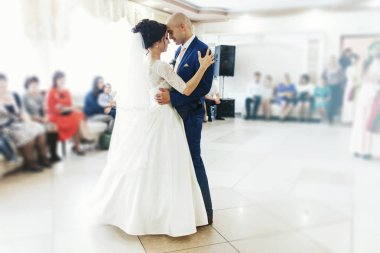 Wedding couple in love dances
