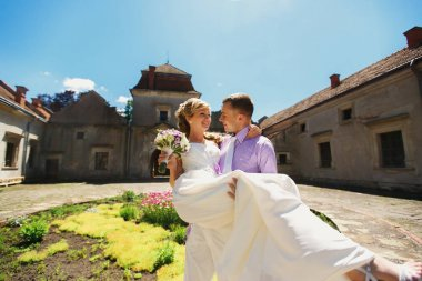 Newlyweds on the backyard of an old castle