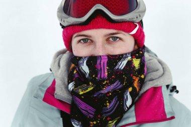 Snowboarder woman in snowy mountains