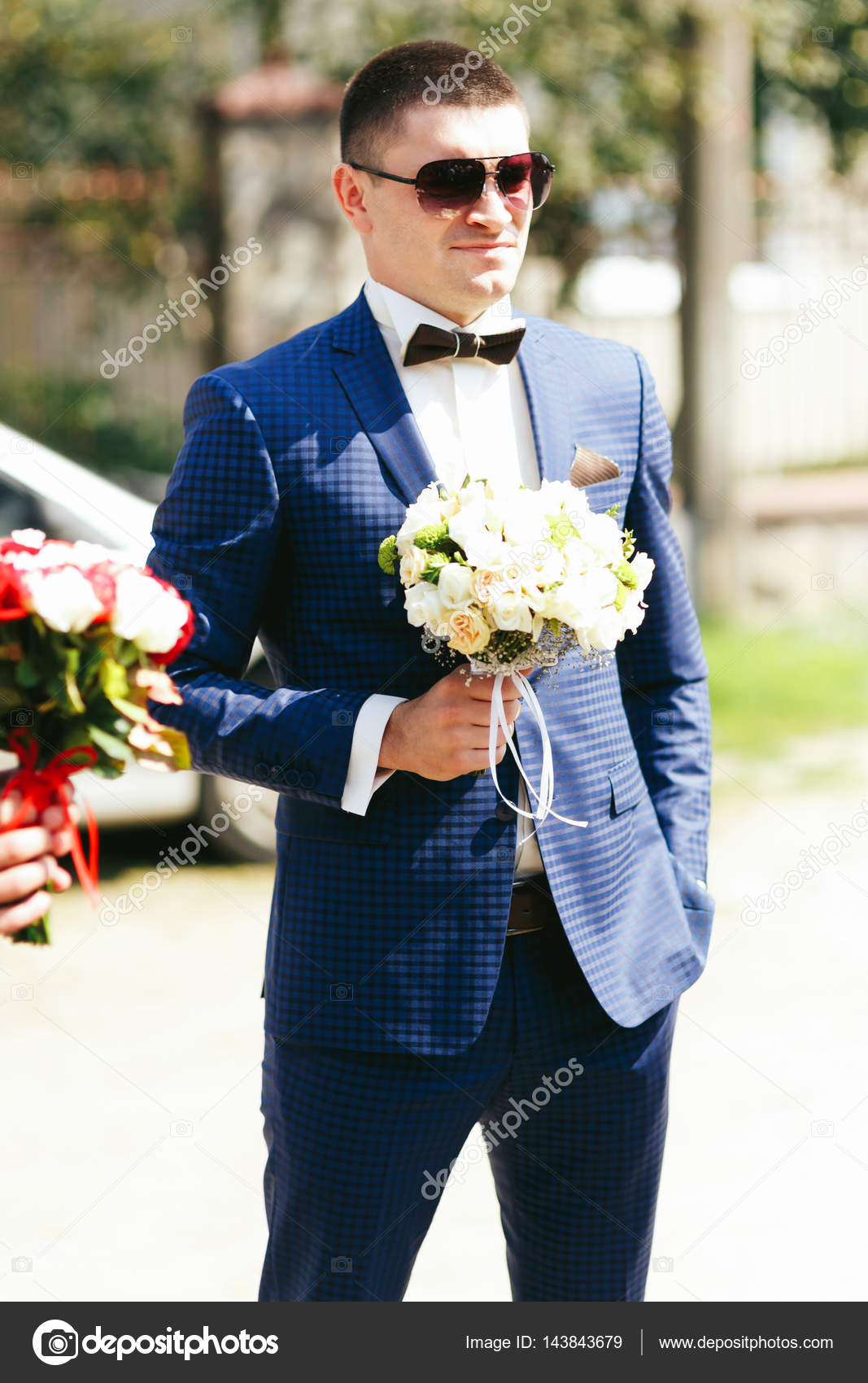 Stylish groom in blue suit — Stock Photo © olexiysyrotkin #143843679