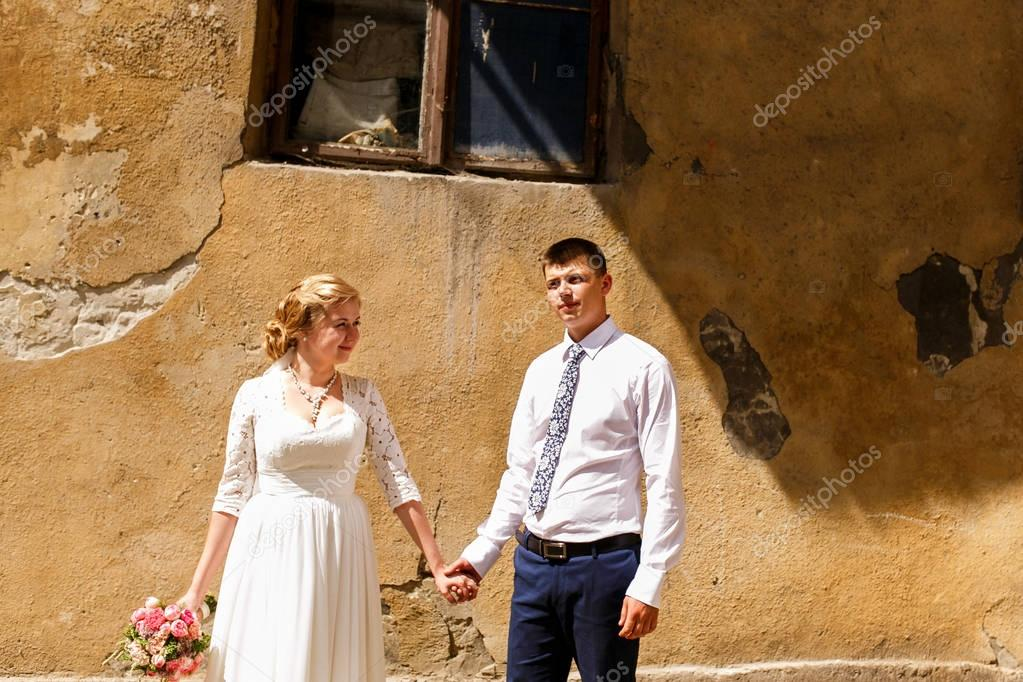Happy newlyweds in old european city