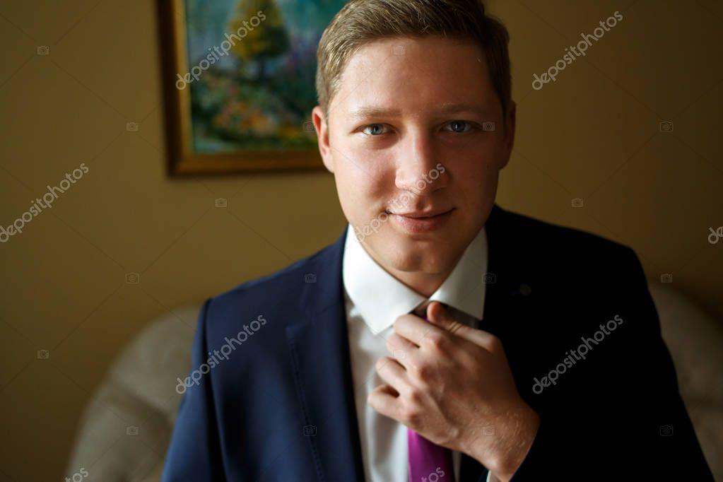 Handsome groom on wedding day