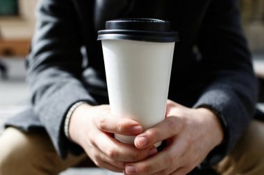 Man holding coffee to-go