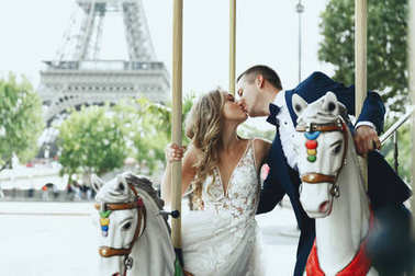 Classy wedding couple poses in the lunapark somewhere in Paris