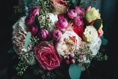 Rich wedding bouquets made of roses and hydrangeas