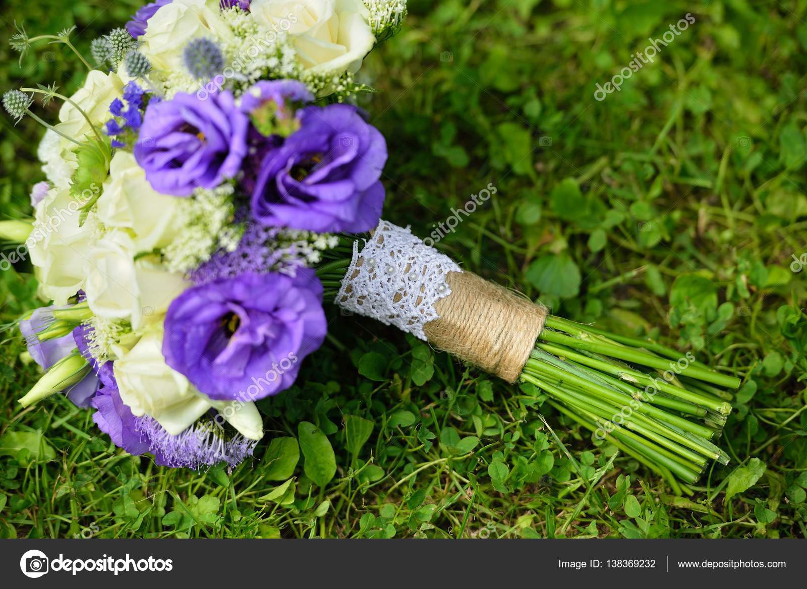 Close up of wedding bouquet with white and purple flowers on green close up of wedding bouquet with white and purple flowers on green grass stock izmirmasajfo